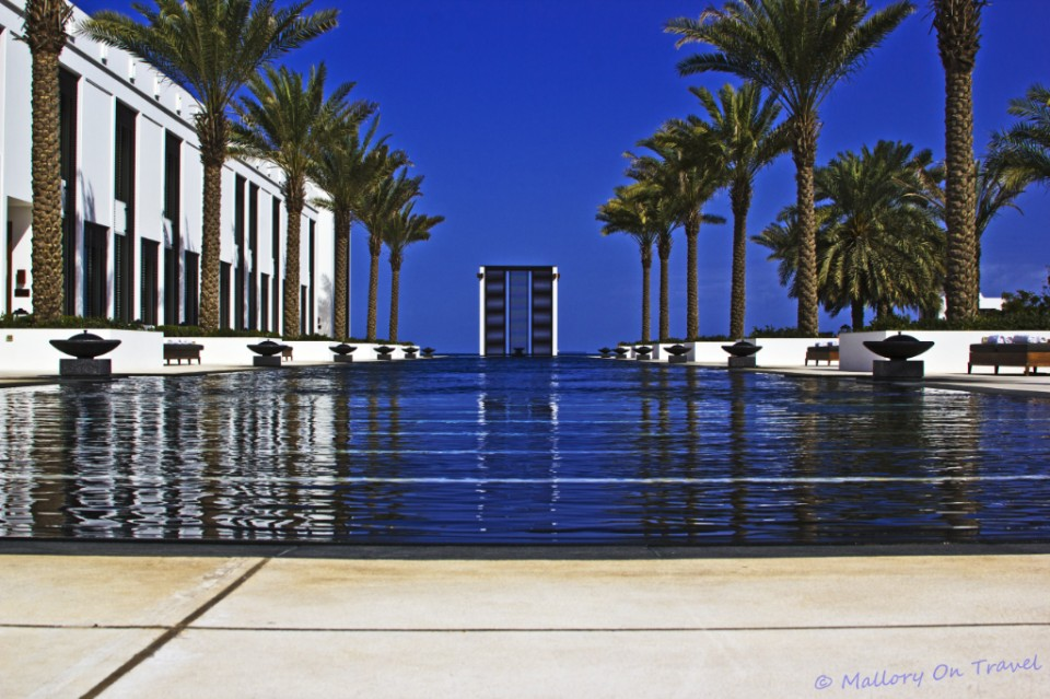 The 103m Long Pool at The Chedi a luxury 5 star hotel in Muscat, Oman on Mallory on Travel adventure photography