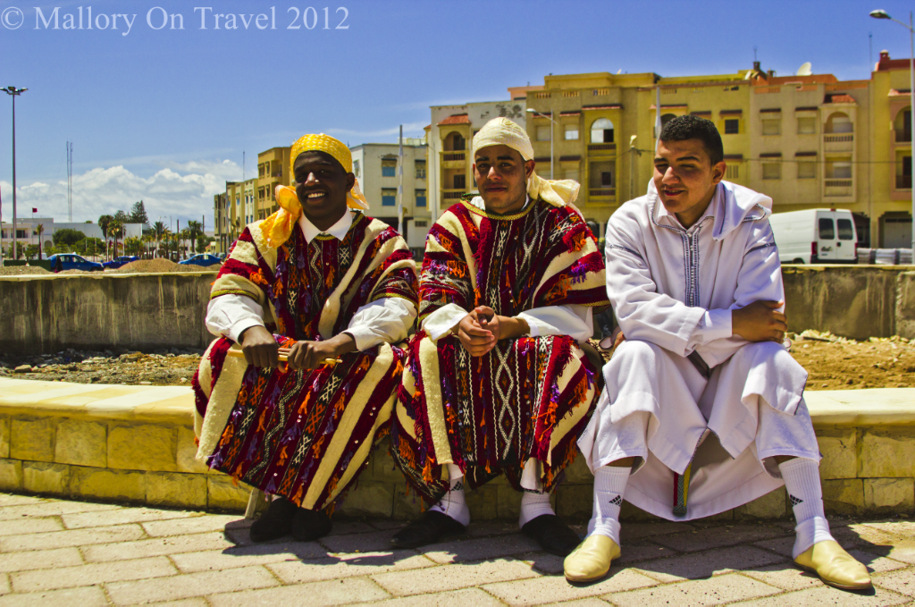 Three friends in the Moroccan city of Essaouira on the North African Atlantic coast on Mallory on Travel adventure photography