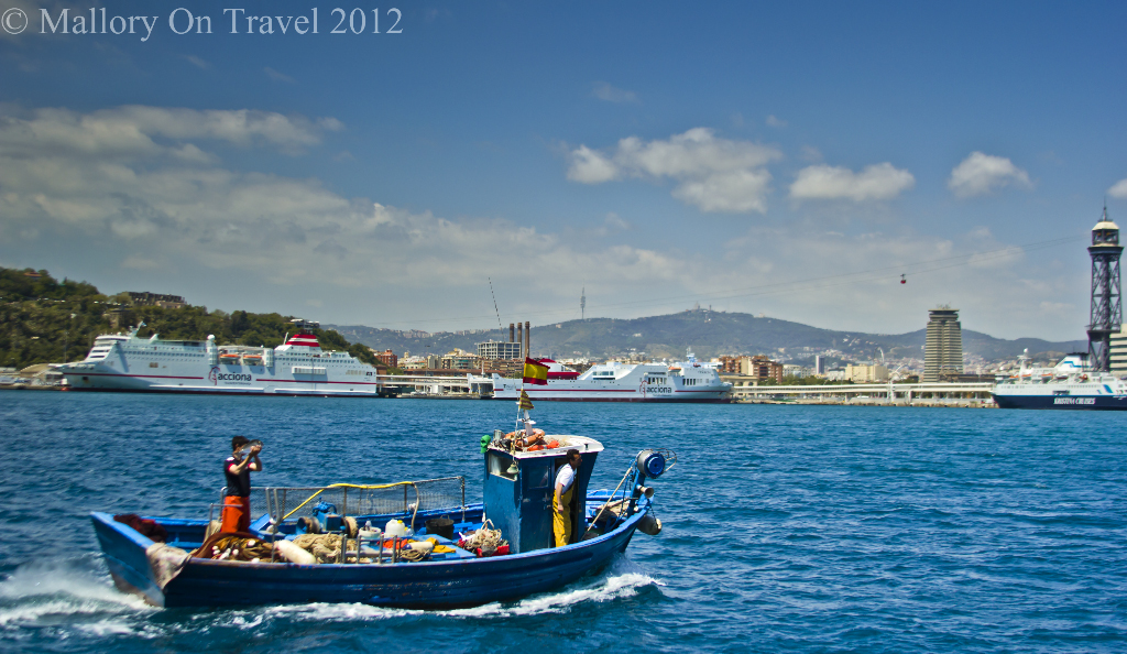 Fishing vessel heading to port with the day's catch in Barcelona in Catalonia, Spain on Mallory on Travel adventure photography