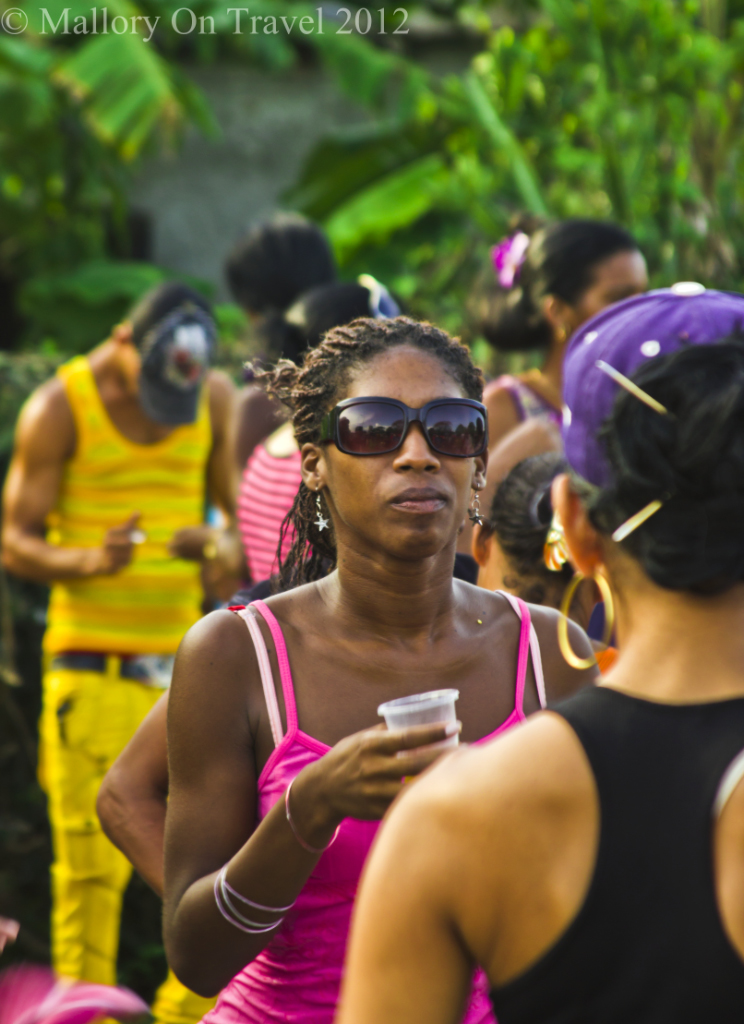 Cuban cool, a girl at the Camaguey carnival on Caribbean Cuba on Mallory on Travel adventure photography