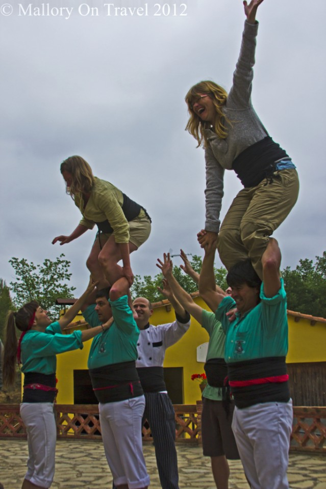Bloggers building castells in the Catalan, Spain on Mallory on Travel adventure photography