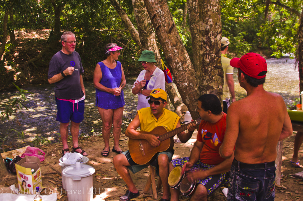 Muscians performing at a barbecue near Baracoa, Cuba on Mallory on Travel adventure photography
