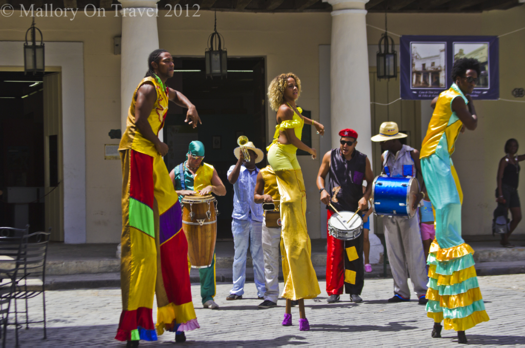 Performers and musicians in the Old Square of Havana, Cuba on Mallory on Travel adventure photography