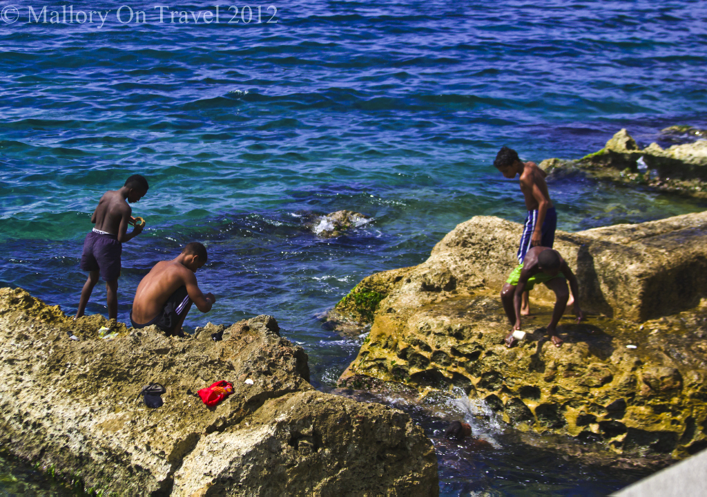 Children swimming on the Malecón in Havana, Cuba on Mallory on Travel adventure photography