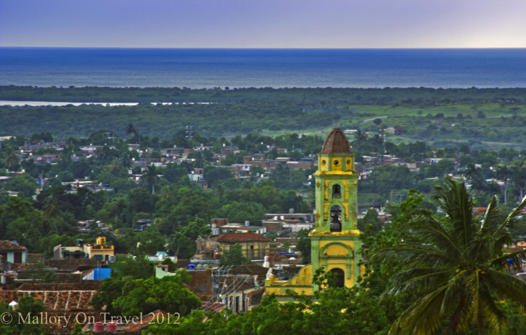 Looking down over the Cuban town of Trinidad with the belltower of St Francis on Mallory on Travel adventure photography