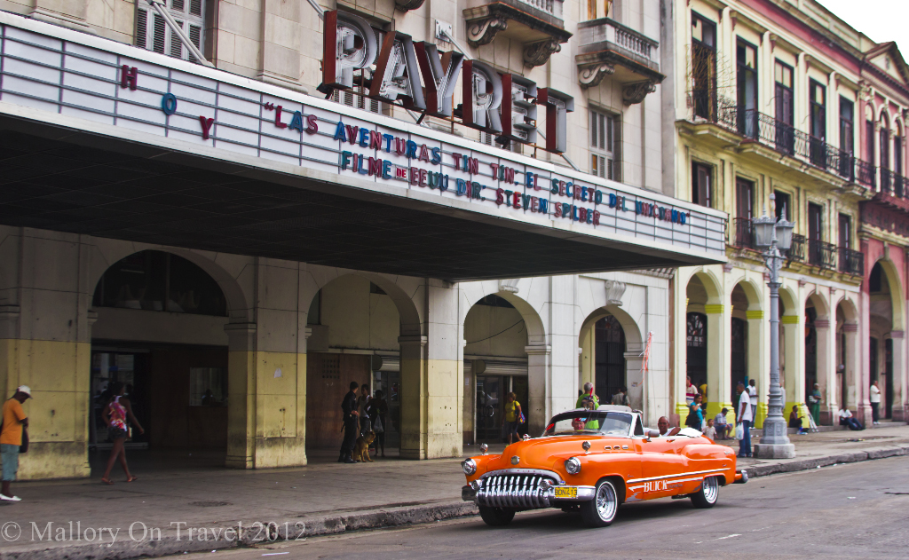Classic Buick convertible car in front of an Old Havana picture house Cuba on Mallory on Travel adventure photography