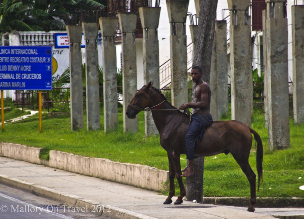 Horserider on the streets of Cienfeugos on Cuba on Mallory on Travel adventure photography