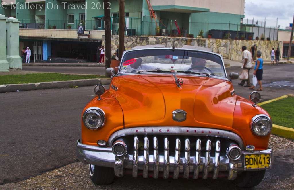 A classic Buick Eight convertible car in New Havana, Cuba on Mallory on Travel adventure photography