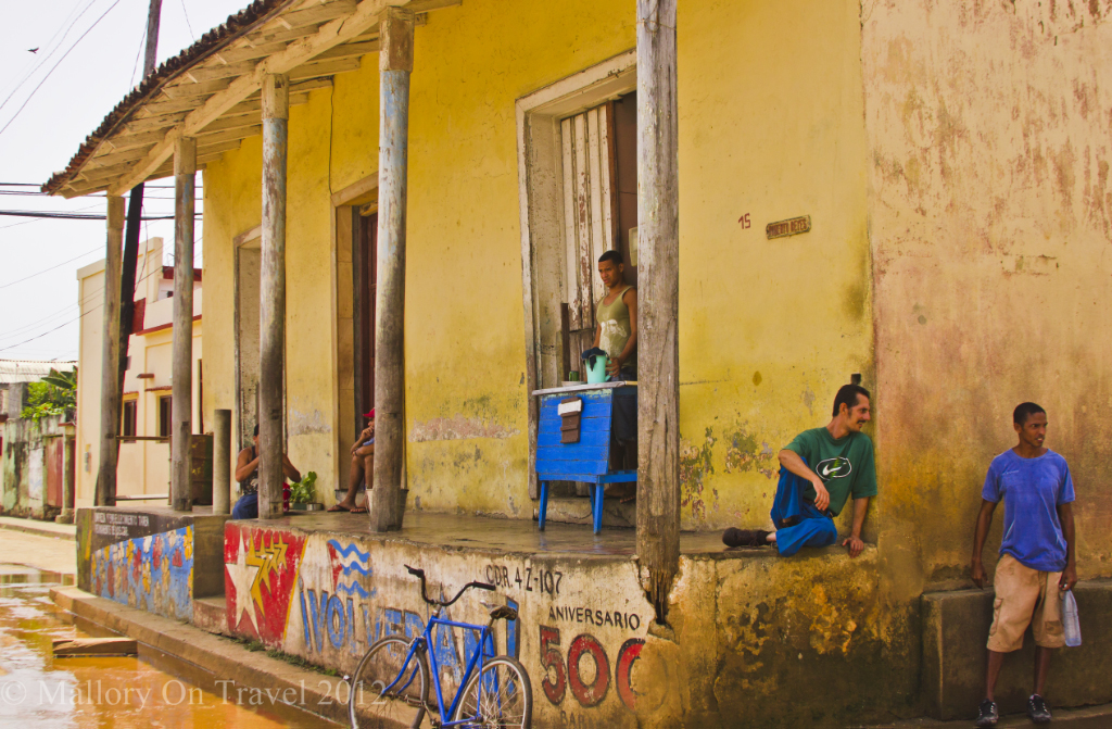 Local cubans  outside a building in Baracoa in Cuban on Mallory on Travel adventure photography