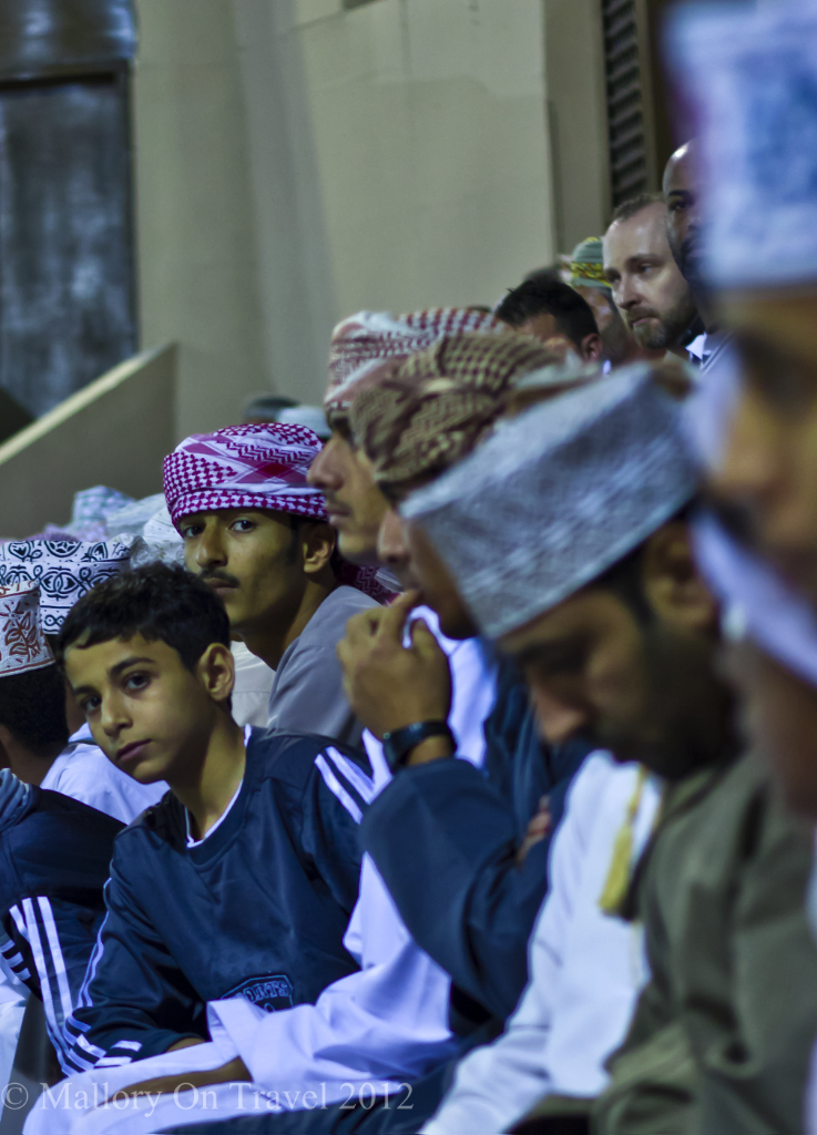 Face in the crowd at the Muscat Festival in Oman on Mallory on Travel adventure photography