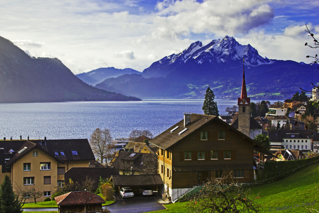Alpine village of Wengis on the shore of Lake Lucerne in Switzerland with Mount Pilatus on Mallory on Travel adventure photography