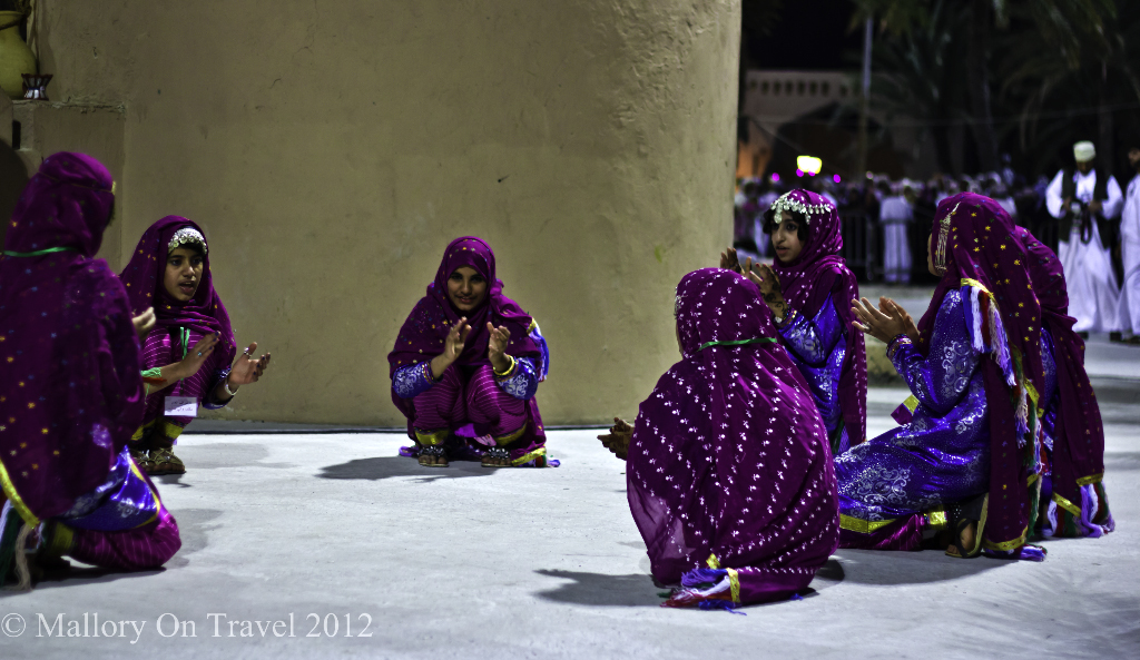 Girls playing and singing at the Muscat Festival in Oman on Mallory on Travel adventure photography
