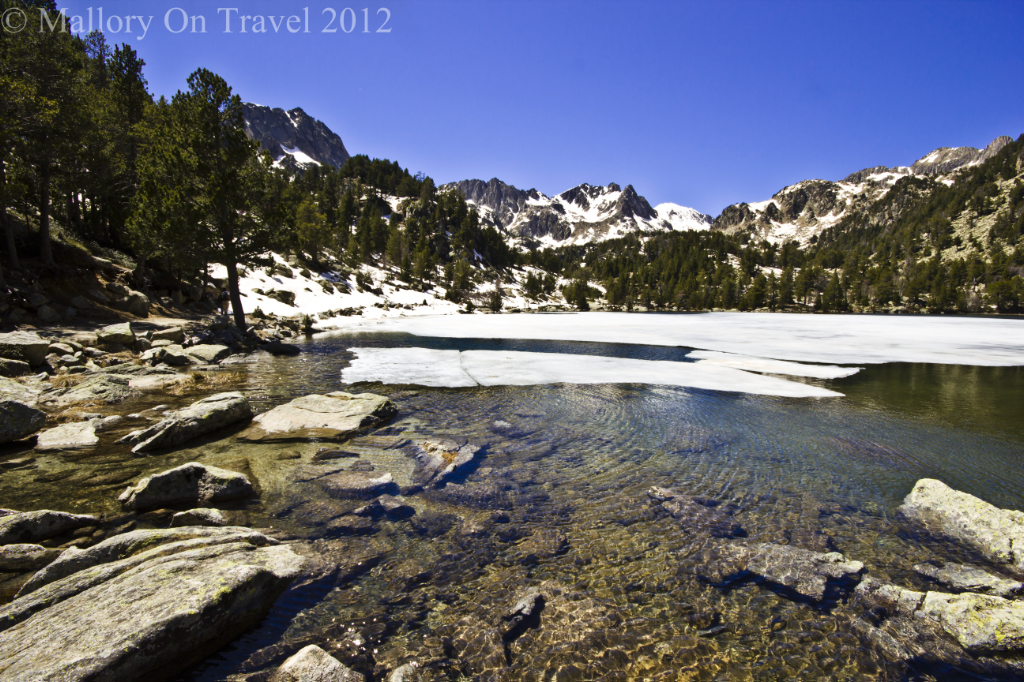 The mountains and glacial lakes of Aigüestortes i Estanys de Sant Maurici national park in Catalonian Spain on Mallory on Travel adventure photography