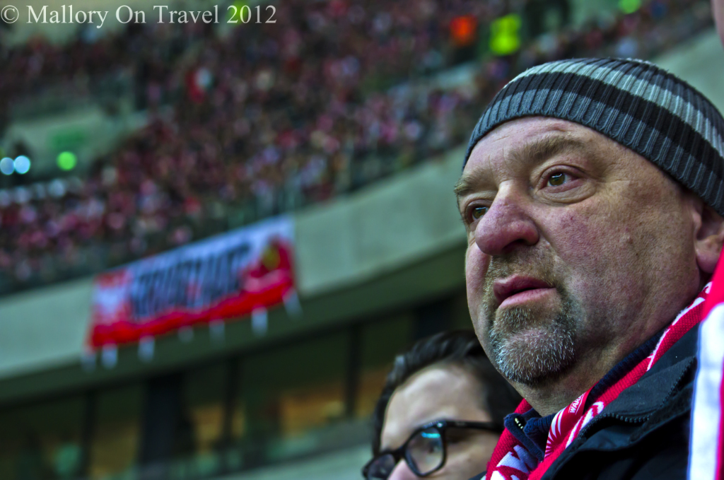 Polish supporter in the crowd at the Nationa Football Stdium in Warsaw, Poland on Mallory on Travel adventure photography