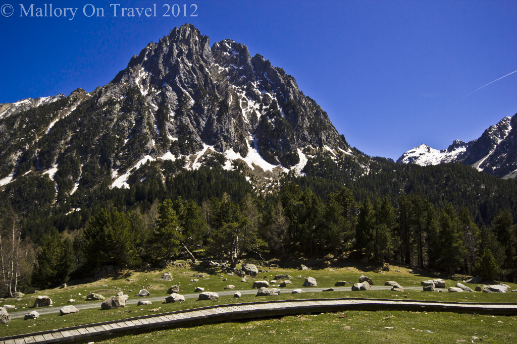 The majestic peaks of the Aigüestortes i Estanys de Sant Maurici national park in Catalonian Spain on Mallory on Travel adventure photography