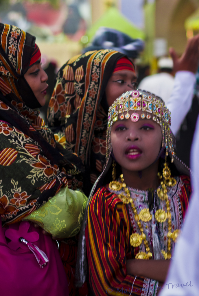 Young girl in traditional Omani costume at the Muscat Festival, Oman on Mallory on Travel adventure photography
