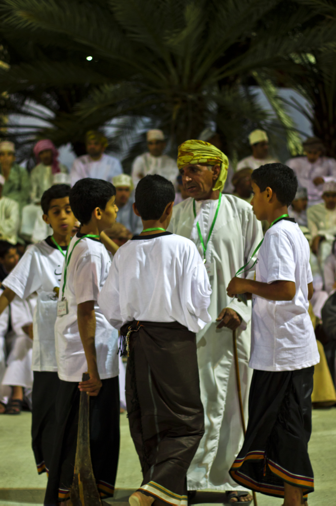 Children playing theatrically at the Muscat Festival in Oman on Mallory on Travel adventure photography