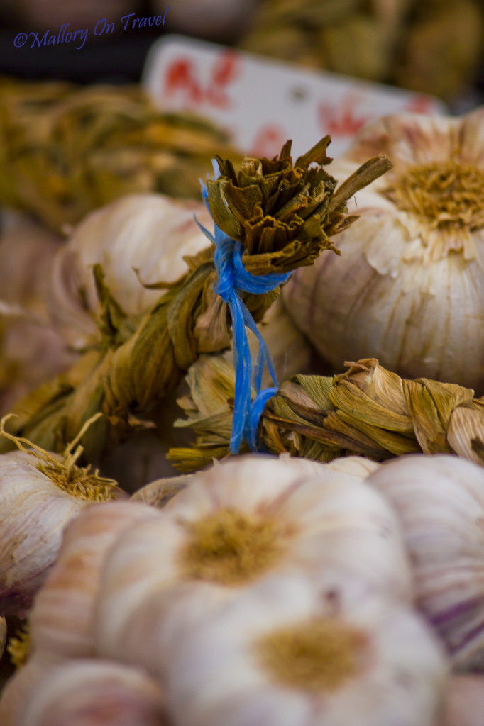 Garlic bulbs on a market stall in the French Pyrenees on Mallory on Travel adventure photography