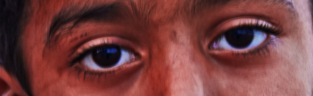 Eyes of an Omani boy in Seeb on Mallory on Travel adventure photography