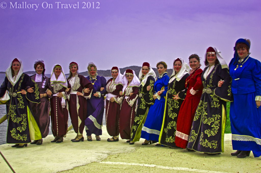 Dancing ladies in Ammouliani off the Greek coast of Halkidiki near Ouranoupolis  on Mallory on Travel adventure photography
