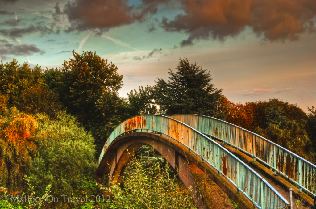 The old footbridge over the river in greenbelt Salford, Manchester, in northern England at the autumn Equinox on Mallory on Travel adventure photography