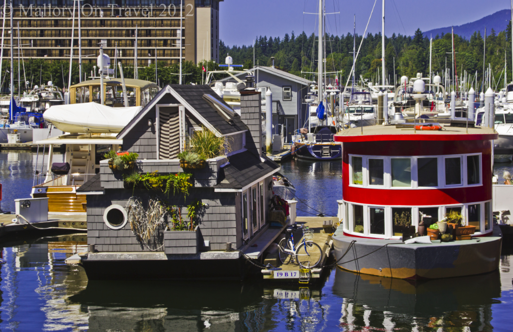 The marina of Vancouver where houseboats can be found with yachts on the coast of British Columbia, Canada on Mallory on Travel adventure photography