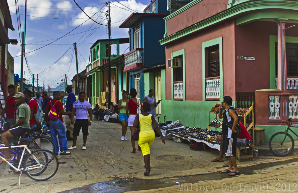 The busy streets of  Baracoa on the island of Cuba in the Caribbean on Mallory on Travel adventure photography