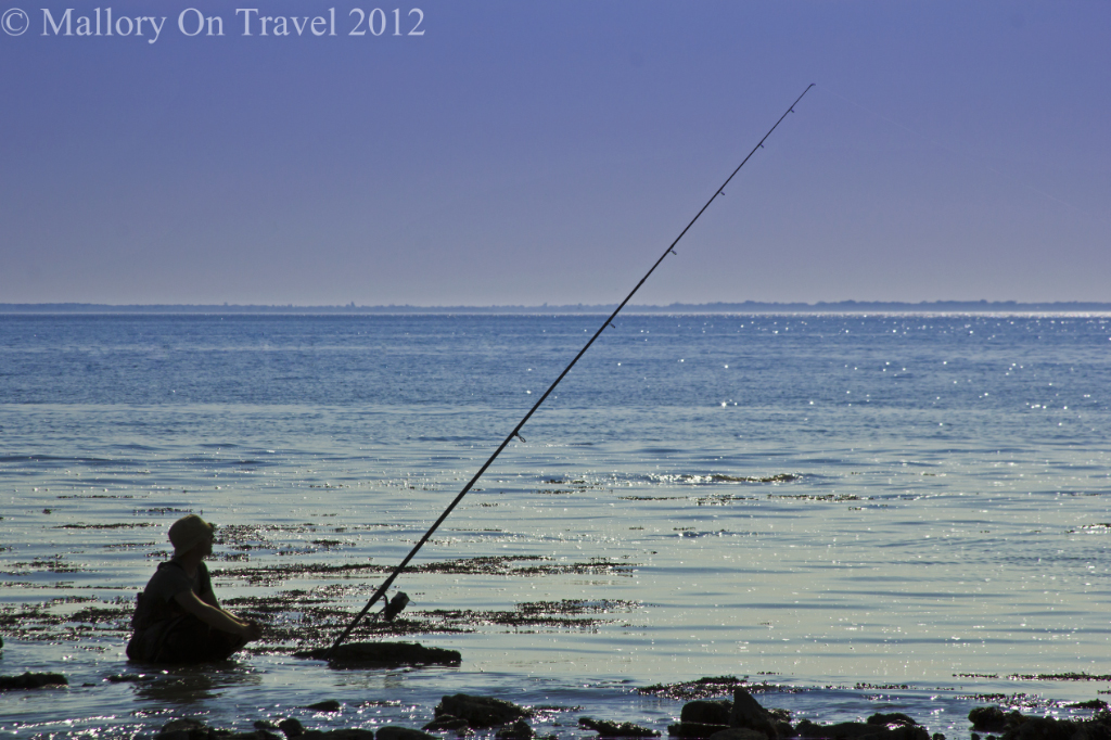 An angler at peace in the region of Charente-Maritime, France on Mallory on Travel adventure photography