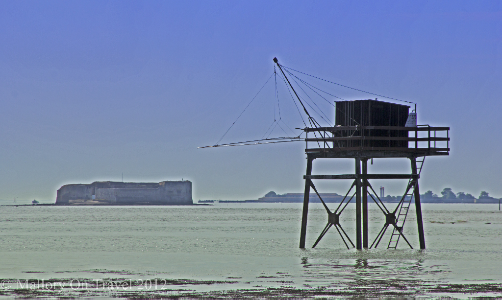 Fishing platform in the region of  Poitou-Charentes, France with Fort Boyard.in the background on Mallory on Travel adventure photography