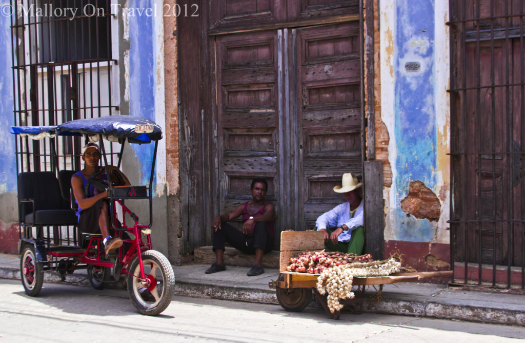 Street vendor and pedi-bike in Trinidad on the Caribbean island of Cuba on Mallory on Travel adventure photography