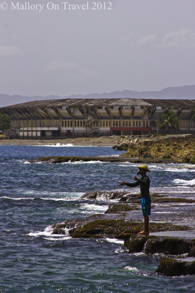 Fishing off the rocks in the Caribbean at Baracoa  on the island of Cuba on Mallory on Travel adventure photography