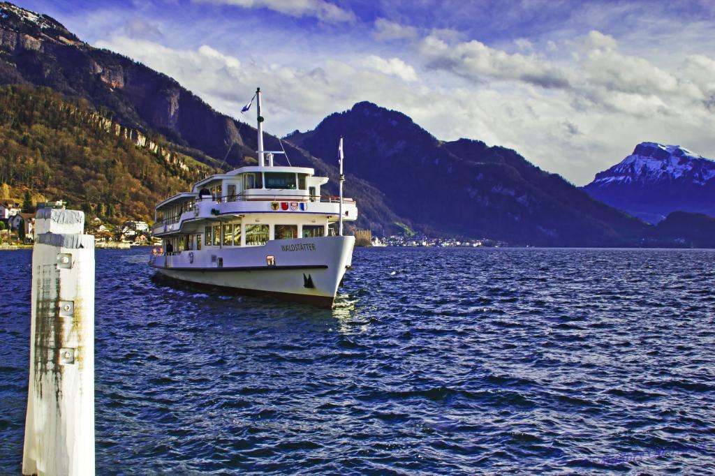 Cruise ship on Lake Lucerne coming in to dock at Weggis, Switzerland