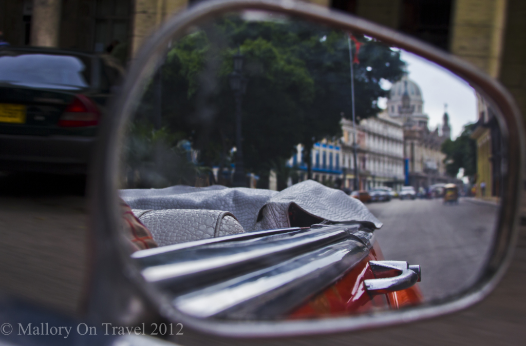 Touring in a classic Buick Eight in Havana, on the Caribbean island of Cuba on Mallory on Travel adventure photography