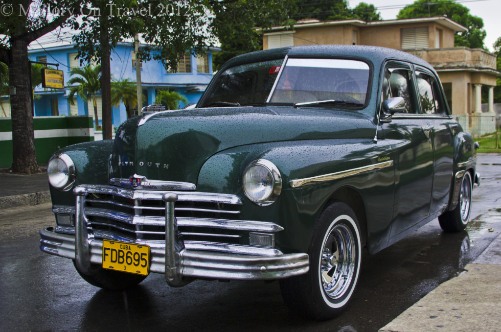 An old Plymouth parked outside a diner in Ceinfeugos, Cuba in the Caribbean  on Mallory on Travel adventure photography