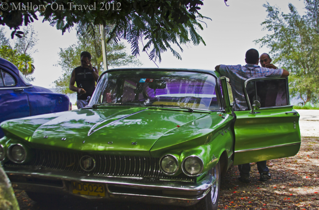 Guys and the car at the Bay of Pigs Cuba on Mallory on Travel adventure photography