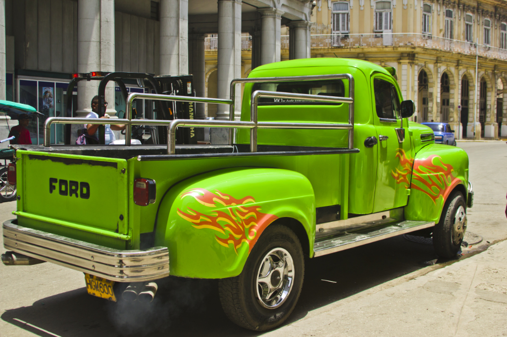 Vibrant green pickup with flame decals in Havana, Cuba in the Caribbean on Mallory on Travel adventure photography