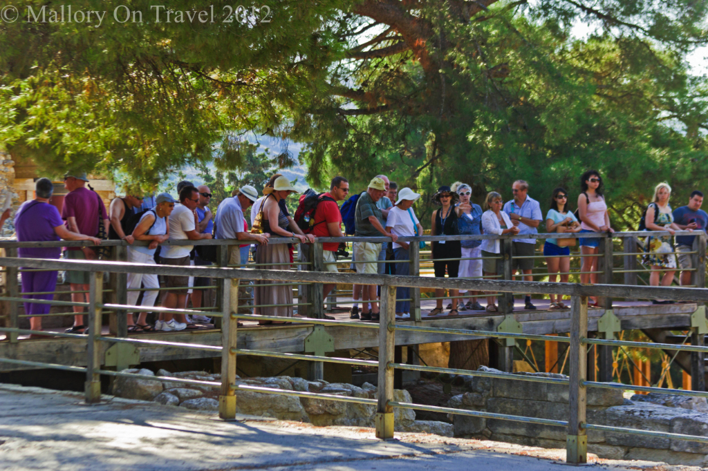 Crowds of tourists on organised excursions at Knossos near Heraklion on the island of Crete, Greece on Mallory on Travel adventure photography
