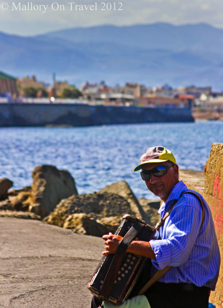 Street performer in the harbour in Heraklion, on the island of Crete, Greece on Mallory on Travel adventure photography