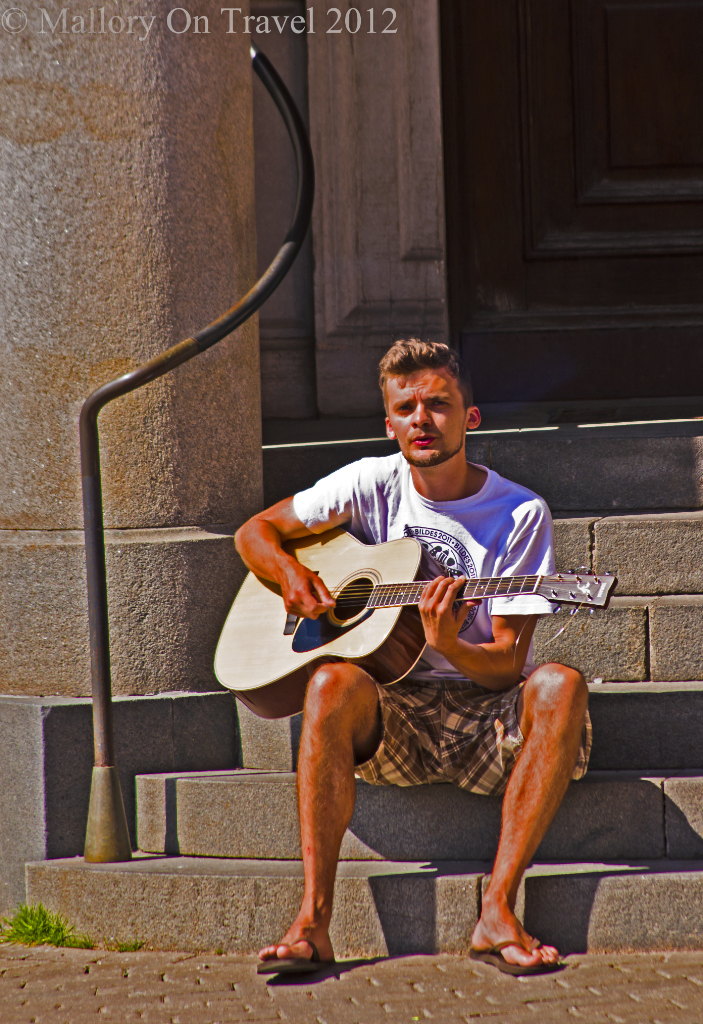Male street performer playing music in Riga the capital city of Latvia on Mallory on Travel adventure photography