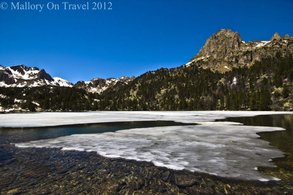 The peaks surrounding Glacier Lake in Catalonia Aigüestortes i Estanys de Sant Maurici National Park on Mallory on Travel adventure photography Iain Mallory-300-49