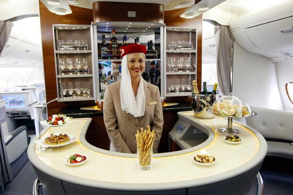 A flight attendant behind the bar in business class section of Emirates' Airbus A380 on Mallory on Travel adventure photography