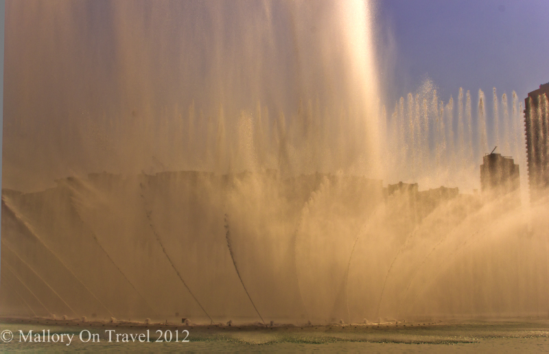 The exploding fountains of the emirate of Dubai in the United Arab Emirates on Mallory on Travel adventure photography