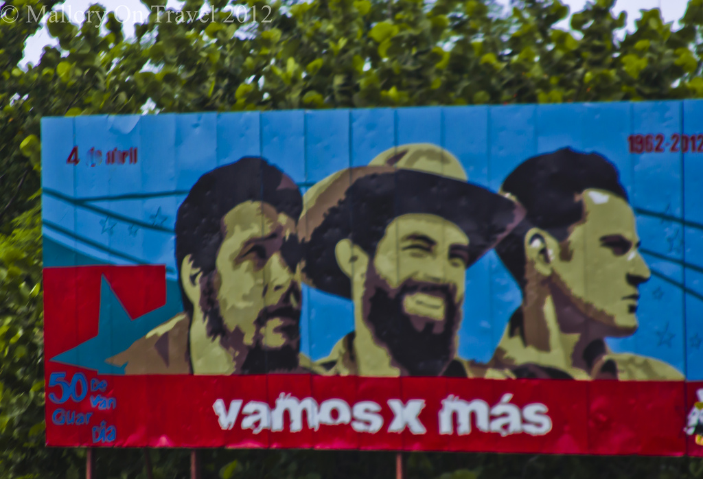 Roadside poster of Che Guevara, Fidel and Raul Castro in Cuba in the Caribbean on Mallory on Travel adventure photography Iain Mallory-300-294