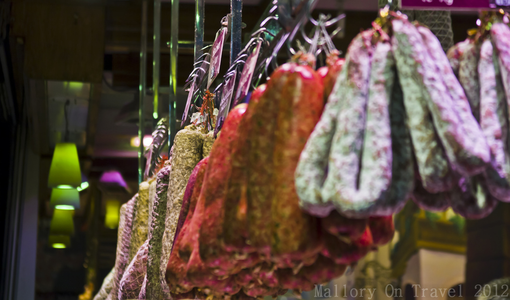 Cured meats in the Lyon Hall market in the Rhone-Alpes region of France on Mallory on Travel adventure photography Iain Mallory-300-60
