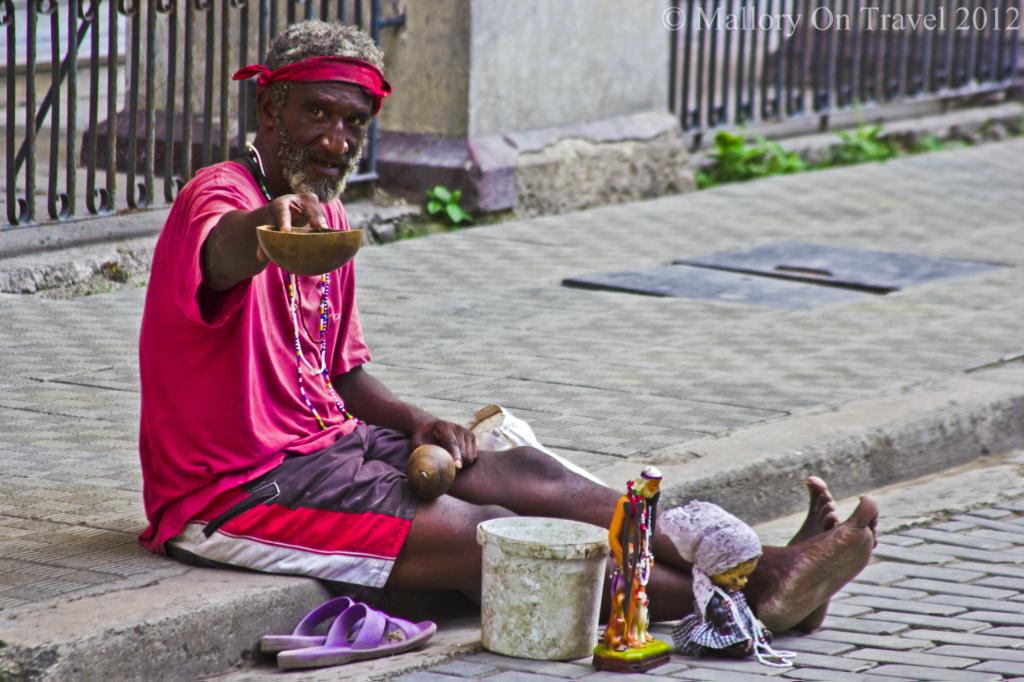 A beggar on the streets of Old Havana on the Caribbean island of Cuba on Mallory on Travel, adventure, photography Iain Mallory-300-109