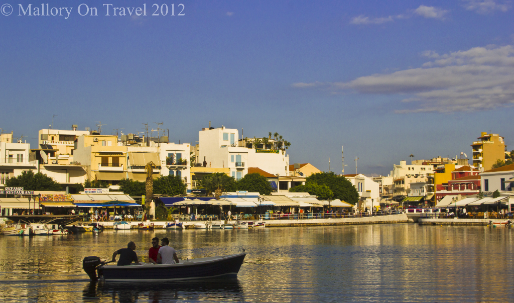 Boating on Voulismeni Lake in the Greek resort of Agios Nikolaos, Crete on Mallory on Travel, adventure, photography