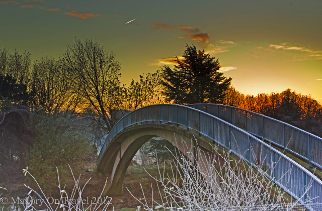 Footbridge over the river in suburban Salford woodland, of greenbelt Manchester in the United Kingdom on Mallory on Travel adventure photography Iain Mallory-300-40_suburban_bridge