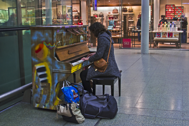 Performing member of the public playing a street piano in St Pancras International Railway Station in London, the United Kingdom on Mallory on Travel, adventure, adventure travel, photography Iain Mallory-300-41 street-piano