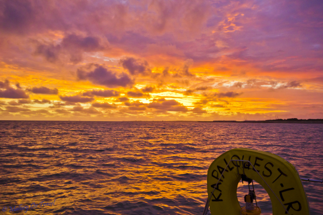 Romantic destination; Sunset sailing a catamarran on the Atlantic Ocean near La Rochelle in the Poitou-Charentes, France on Mallory on Travel, adventure, adventure travel, photography Iain_Mallory_009988