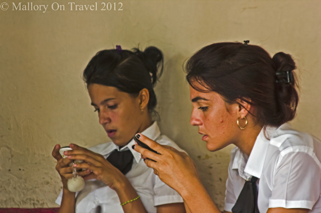 International Women's Day; Texting girls in Trinidad on the Caribbean island of Cuba on Mallory on Travel, adventure, adventure travel, photography Iain Mallory-300-178 trinidad_girls